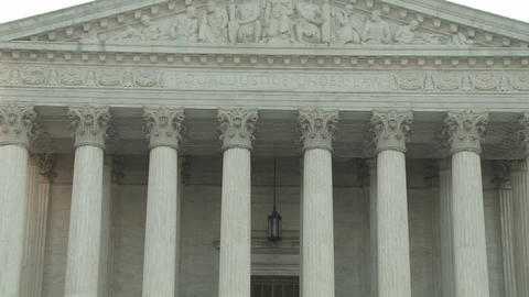A zoom back from the Equal Justice Under Law sign at the Supreme Court Building in Washington DC Footage