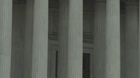 Zoom back from the pillars of the Supreme Court Building... Stock Video Footage