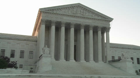 Zoom back from the pillars of the Supreme Court Building in Washington DC Live Action