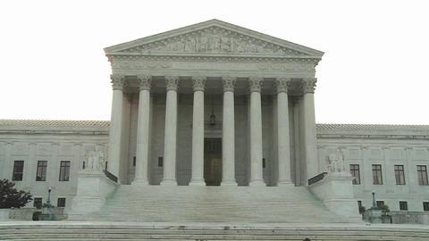 An establishing shot of the Supreme Court Building in Washington DC Footage