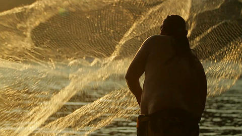 Classic shot of Polynesian fisherman throwing net Stock Video Footage