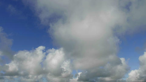 Time lapse of clouds against blue sky moving forwa Stock Video Footage