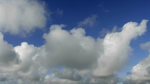 Time lapse of clouds against blue sky moving forwa Footage