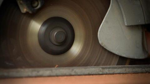 A circular saw cutting through wood at a workbench Stock Video Footage