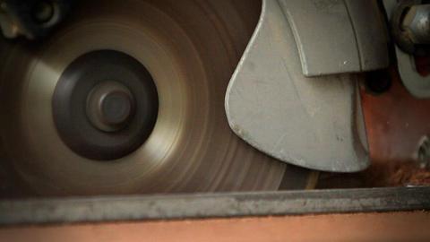 A circular saw cutting through wood at a workbench Footage