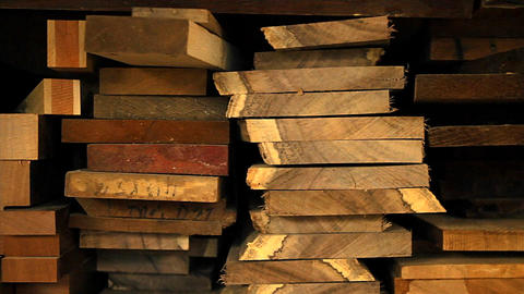 Planks of wood and lumber are stacked vertically Stock Video Footage