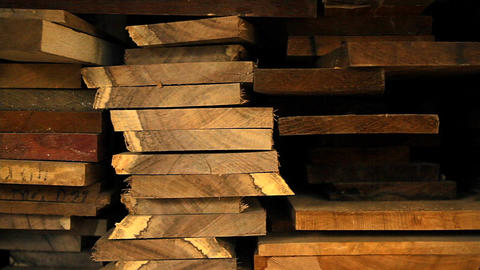 Planks of wood and lumber are stacked vertically Footage