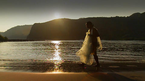 Classic shot of Polynesian fisherman walking on a Stock Video Footage