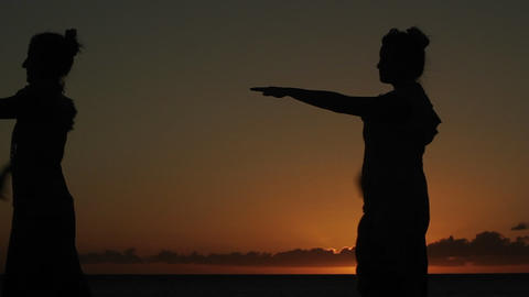 Native Hawaiian dancers perform at sunset Footage