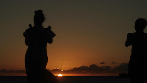 Native Hawaiian dancers perform at sunset Stock Video Footage