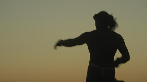 Beautiful Hawaiian dancing against the sunset Stock Video Footage