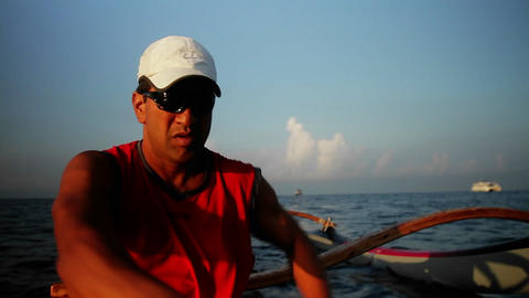 A man rows an outrigger canoe on the ocean Stock Video Footage
