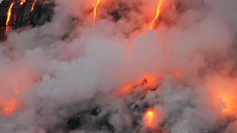 Spectacular dusk lava flow from a volcano into oce Footage