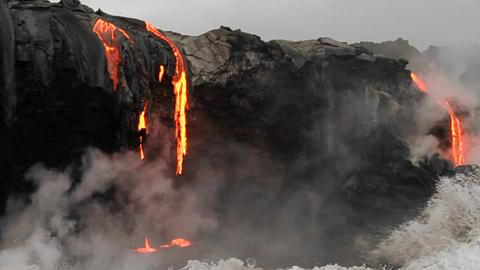 Spectacular dusk lava flow from a volcano into oce Stock Video Footage