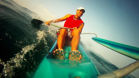 POV of a man rowing an outrigger canoe Stock Video Footage