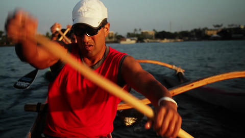 A man rows an outrigger canoe fast Footage