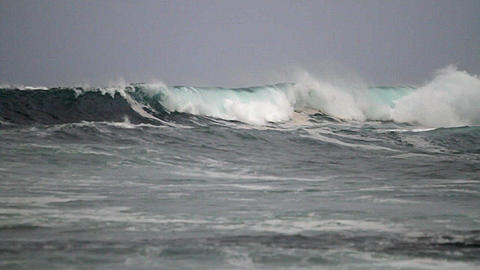 Big waves roll in after a storm on the ocean Footage