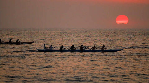 A beautiful shot of outrigger canoes passing befor Footage