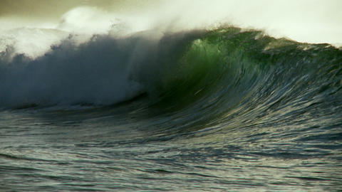 Large waves crest and break in slow motion Stock Video Footage