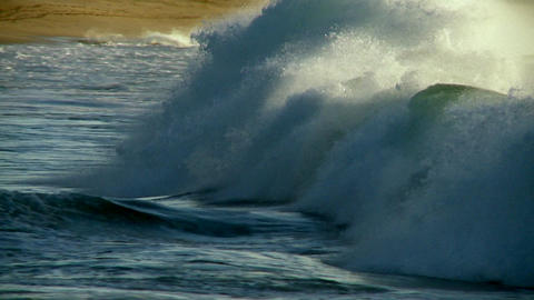 A photographer follows large waves as they crest a Stock Video Footage