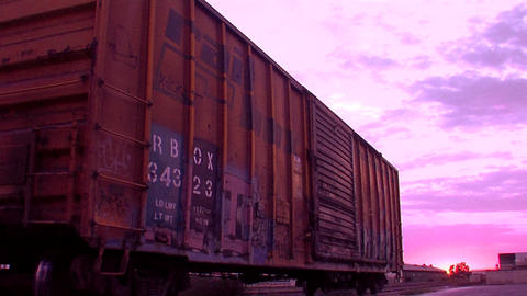An Old Boxcar Sits On A Siding In This Stylized Shot stock footage