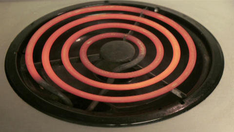 An oven heating coil warms to red hot status Stock Video Footage