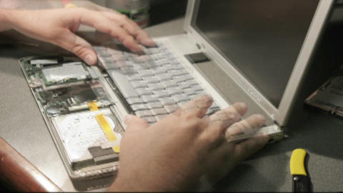 A time lapse shot of hands putting together a laptop... Stock Video Footage