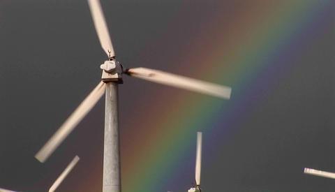 Gorgeous rainbows illuminate wind powered generators... Stock Video Footage