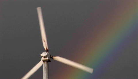 Gorgeous rainbows illuminate wind powered generators spinning Footage