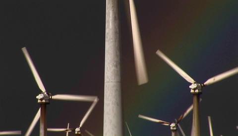 Tilt up to gorgeous rainbows illuminate wind powered... Stock Video Footage