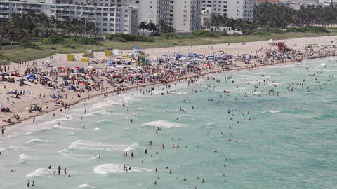 Wide shot Miami Florida extremely crowded baches f Stock Video Footage