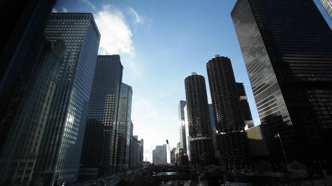 Traffic passing by skyscrapers in Chicago Stock Video Footage
