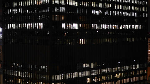 A large building has many lighted windows at night Stock Video Footage