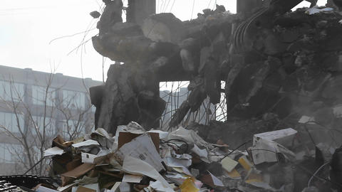 An excavator removes debris Stock Video Footage