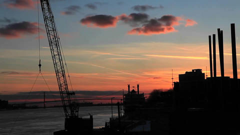 The sun sets as the clouds pass over a factory region... Stock Video Footage