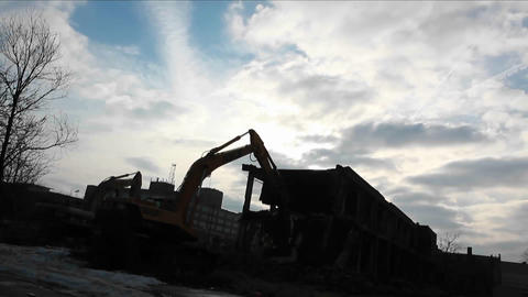 A bulldozer equipment is clearing materials from one... Stock Video Footage