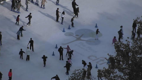 People are enjoying ice skating on a snowy floor Stock Video Footage