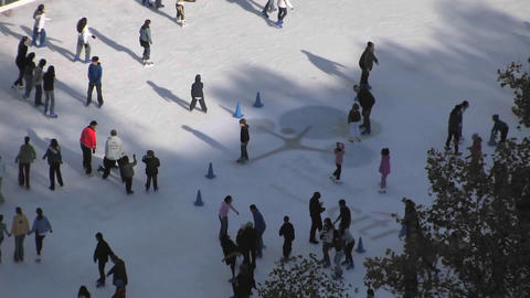 People are enjoying ice skating on a snowy floor Footage