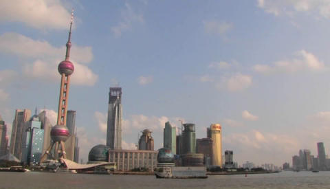 An establishing shot of Shanghai, China with the Huangpu River in foreground Footage