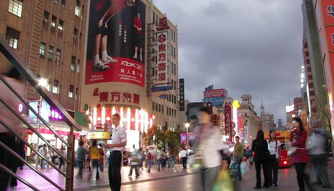 People on a busy urban street in Asia Stock Video Footage