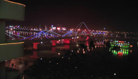 View from an apartment of a bridge over a river at night Stock Video Footage