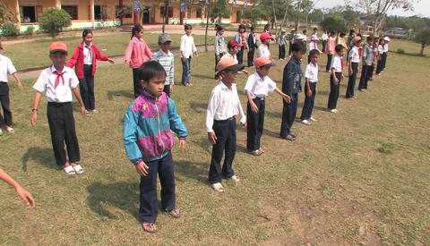 Students Of Primary School Doing Exercise In The School Playground In China stock footage