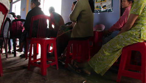 A woman speaking Vietnamese in front of a seated audience Stock Video Footage