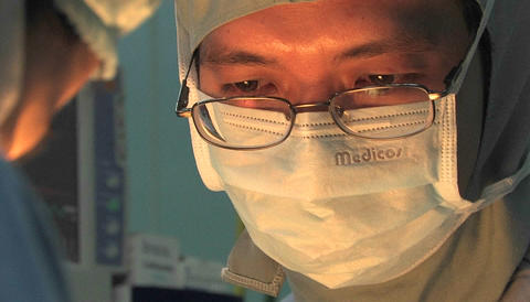 Surgeons perform an operation Stock Video Footage