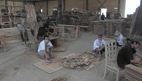Wood workers hard at work crafting hand made furniture Stock Video Footage