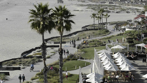 People enjoying the bike path on the beach in fron Stock Video Footage