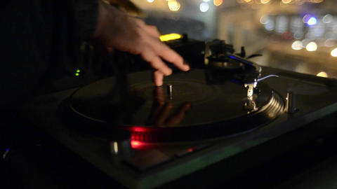 Closeup of a disc Jockey spinning records and play Stock Video Footage