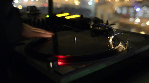 Closeup of a disc Jockey spinning records and play Footage