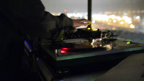 Disc Jockey spinning records on two turntables and Stock Video Footage