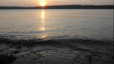 Time lapse of the sun setting into Bartlett Cove i Stock Video Footage